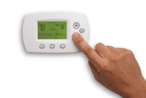 digital-thermostat-hand