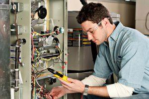service-technician-and-furnace